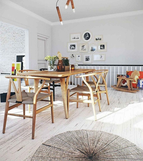 Light-filled-Scandinavian-dining-area-with-wishbone-chairs-and-wooden-table.jpg